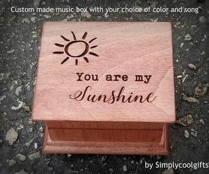 music box, custom made, and sun image