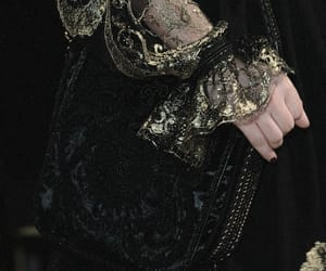 black, gold, and sleeve image