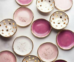 pink, gold, and plate image