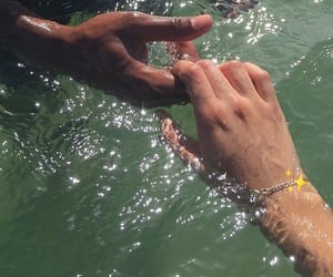 water, hands, and couple image
