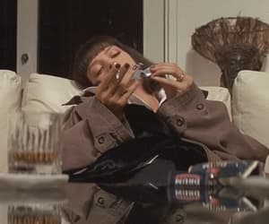 gif, pulp fiction, and cigarette image