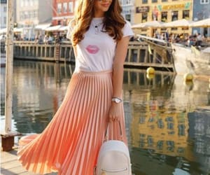top and pleated skirt image