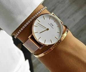accessory, golden, and watch image