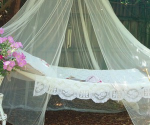 flowers, hammock, and bed image