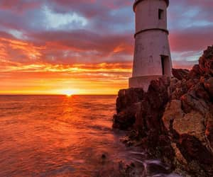 sea, sunset, and ligthouse image