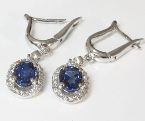 lever back earrings, oval sapphire earrings, and surrounded diamonds image