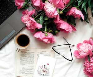 book, flowers, and laptop image