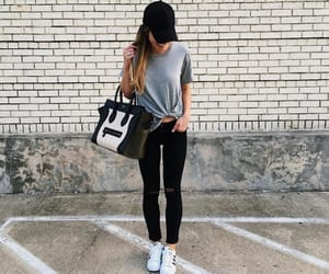 grey t shirt, white shoes, and black jean image