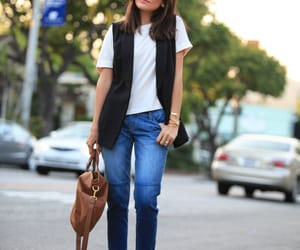 brown bag, black boots, and jeans image