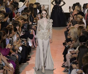 elie saab, paris, and model presents a creation image