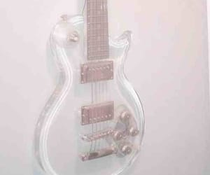 clear, white, and electric guitar image