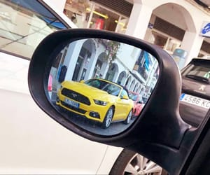 car mirror, cars, and reflection image