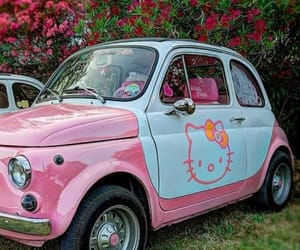 car, hello kitty, and pink image