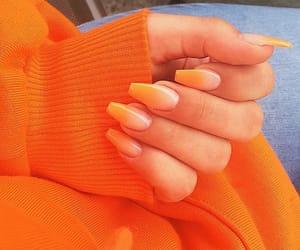 nails, orange, and sweater image