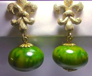 Dangle, green, and gold tone image
