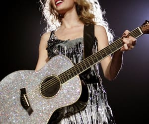 Taylor Swift, guitar, and fearless image