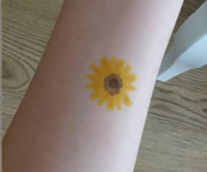 arm, paint, and sunflower image