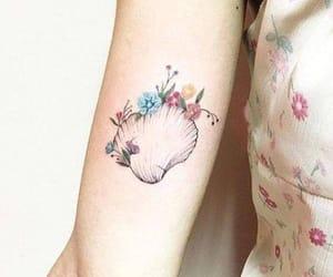ocean, tattoo, and flowera image