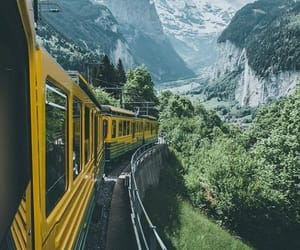 mountains, train, and snow image