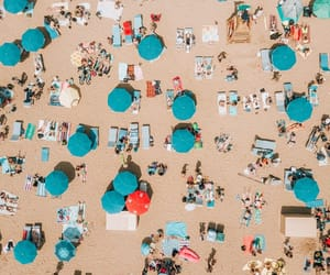 beach, sea side, and sun image