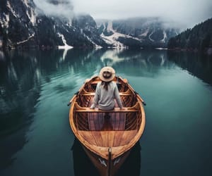 birds, boat, and mountains image