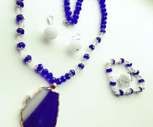 bracelet, earings, and white image