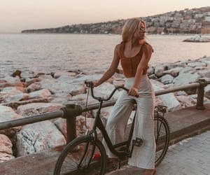 bicycle, blonde, and fashion image