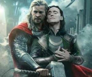 loki laufeyson, chris hemsworth, and tom hiddleston image