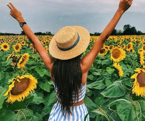 girl and sunflower image