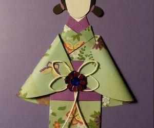card, doll, and green image