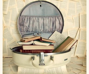 book, glasses, and suitcase image