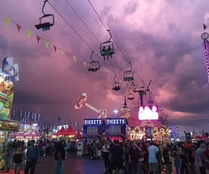 amusement park, carousel, and clouds image