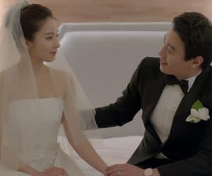 bride, groom, and wedding dress image