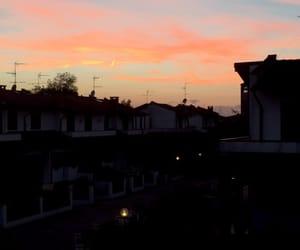 orang, sky, and light image