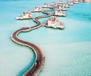 beach, blue ocean, and Maldives image
