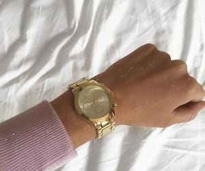 gold, purple, and watch image