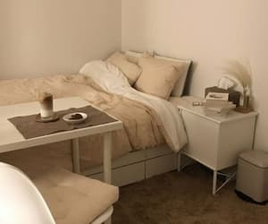 bed, pillows, and beige image