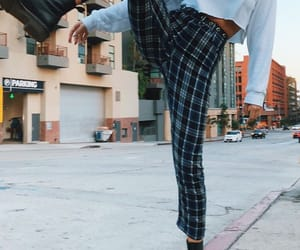 doc martens, plaid pants, and cropped sweater image