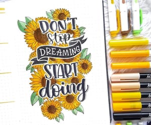 pen, quotes, and sunflower image
