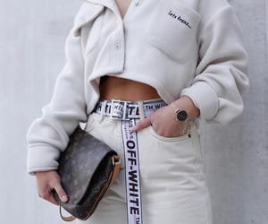 black clutch, white, and watch image