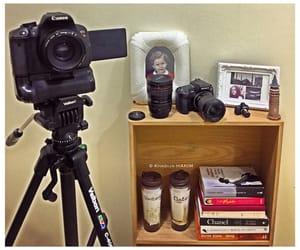 book, bookshelf, and camera image
