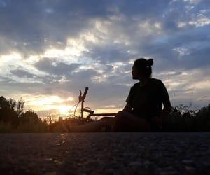 bike, sun, and sunset image