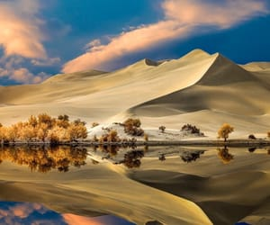clouds, reflections, and sand image