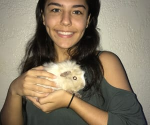 girl and guinea pig image