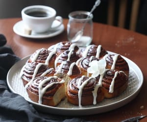 cakes, cinnamon rolls, and coffee image