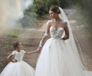 bride, bridesmaid, and dress image