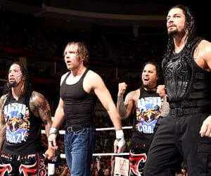roman reigns, jimmy uso, and jey uso image