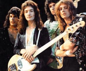 Freddie Mercury, john deacon, and Queen image