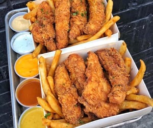 fried chicken, fries, and chicken tenders image