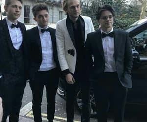 the vamps, suit, and tristan evans image